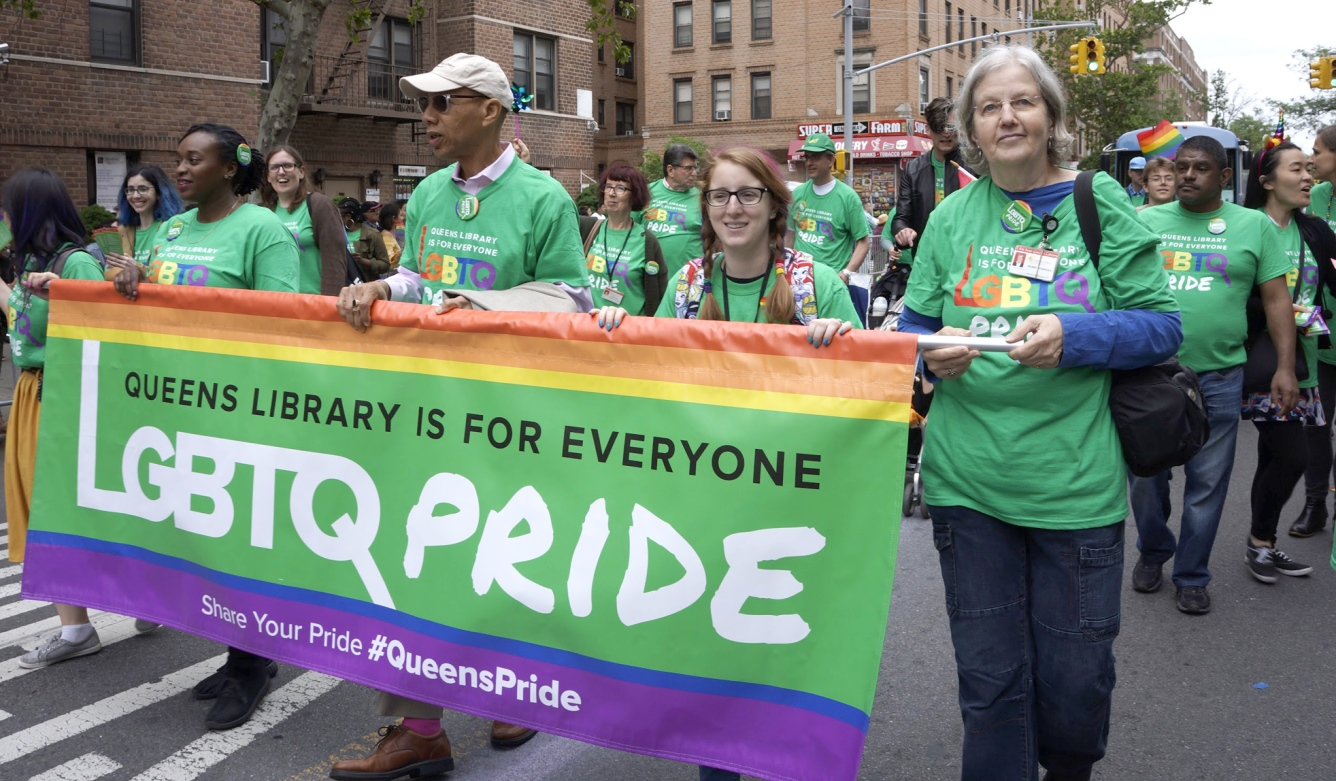 Queens Public Library marched in the 2018 Queens Pride Parade in Jackson Heights.