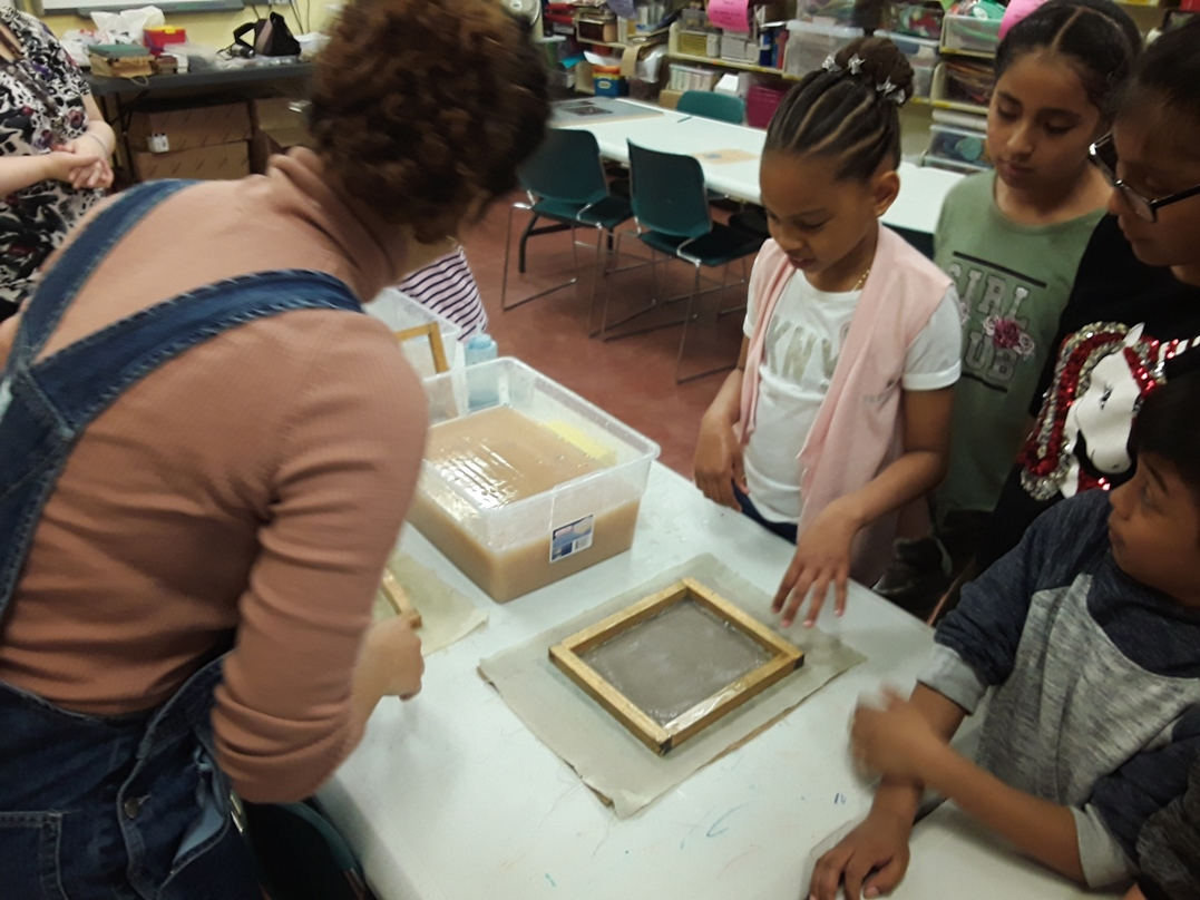 Kids make paper by hand in Week 3 of our Book Creation Workshop.