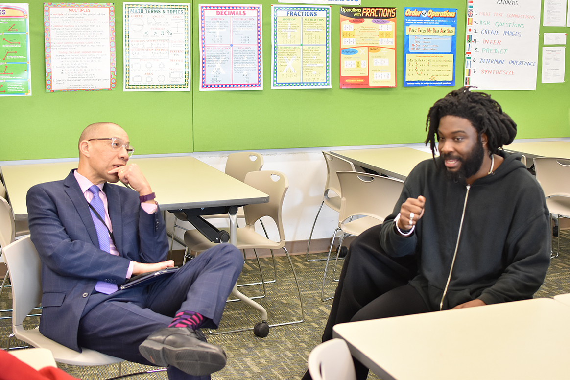 QPL President and CEO Dennis M. Walcott talks with Jason Reynolds at Central Library.