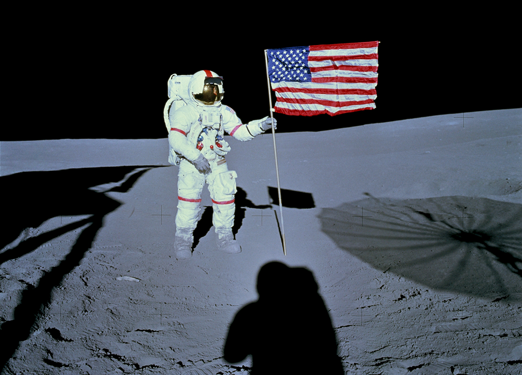 Alan Shepard and the American flag on the Moon during the Apollo 14 mission, February 1971, taken by his fellow astronaut Edgar Mitchell.